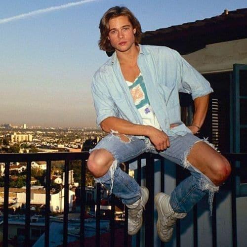 Outfit trashy retro para hombre con jeans desgastados y camisa denim